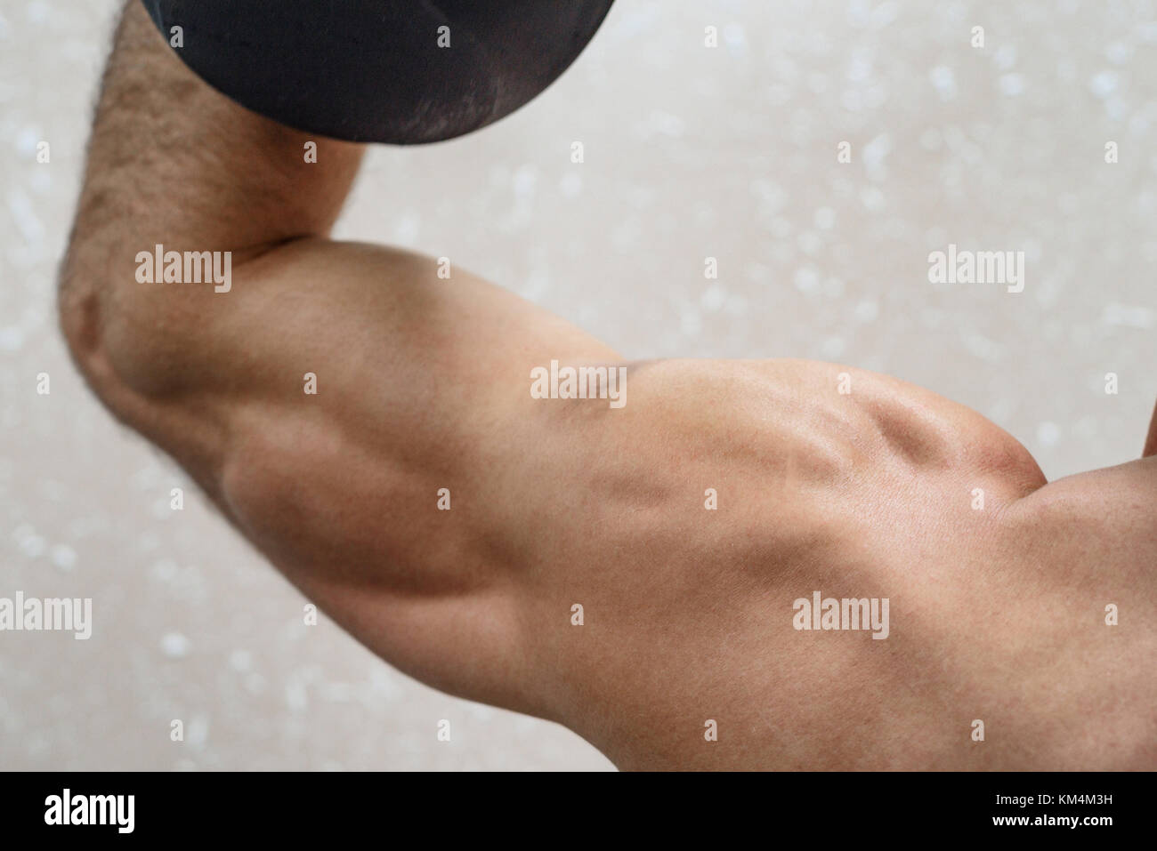 Male athlete doing deltoid exercise with dumbbells Stock Photo