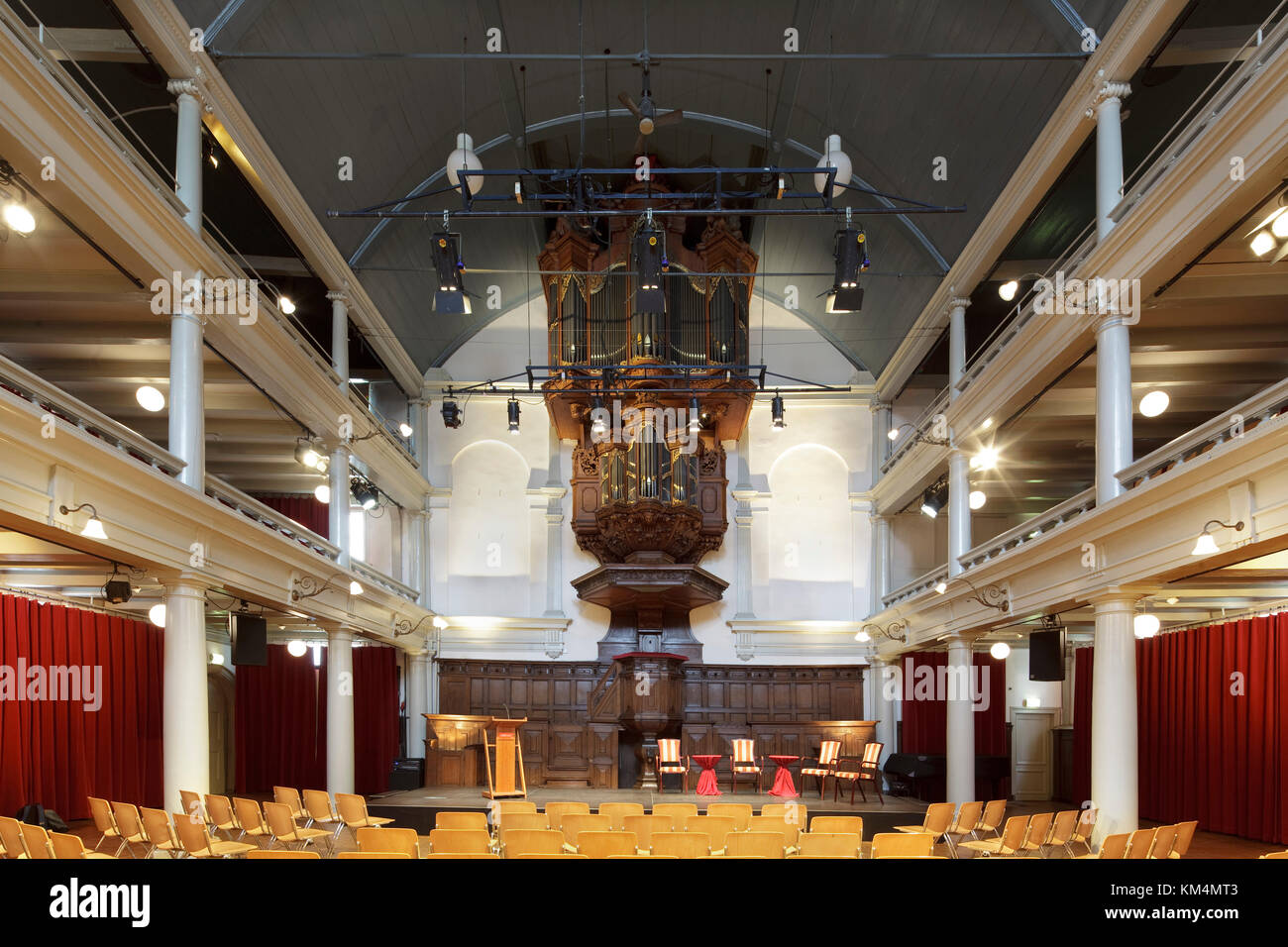 View from rear of auditorium towards stage and organ. De Rode Hoed Cultural Centre, Amsterdam, Netherlands. Architect: - Stock Image