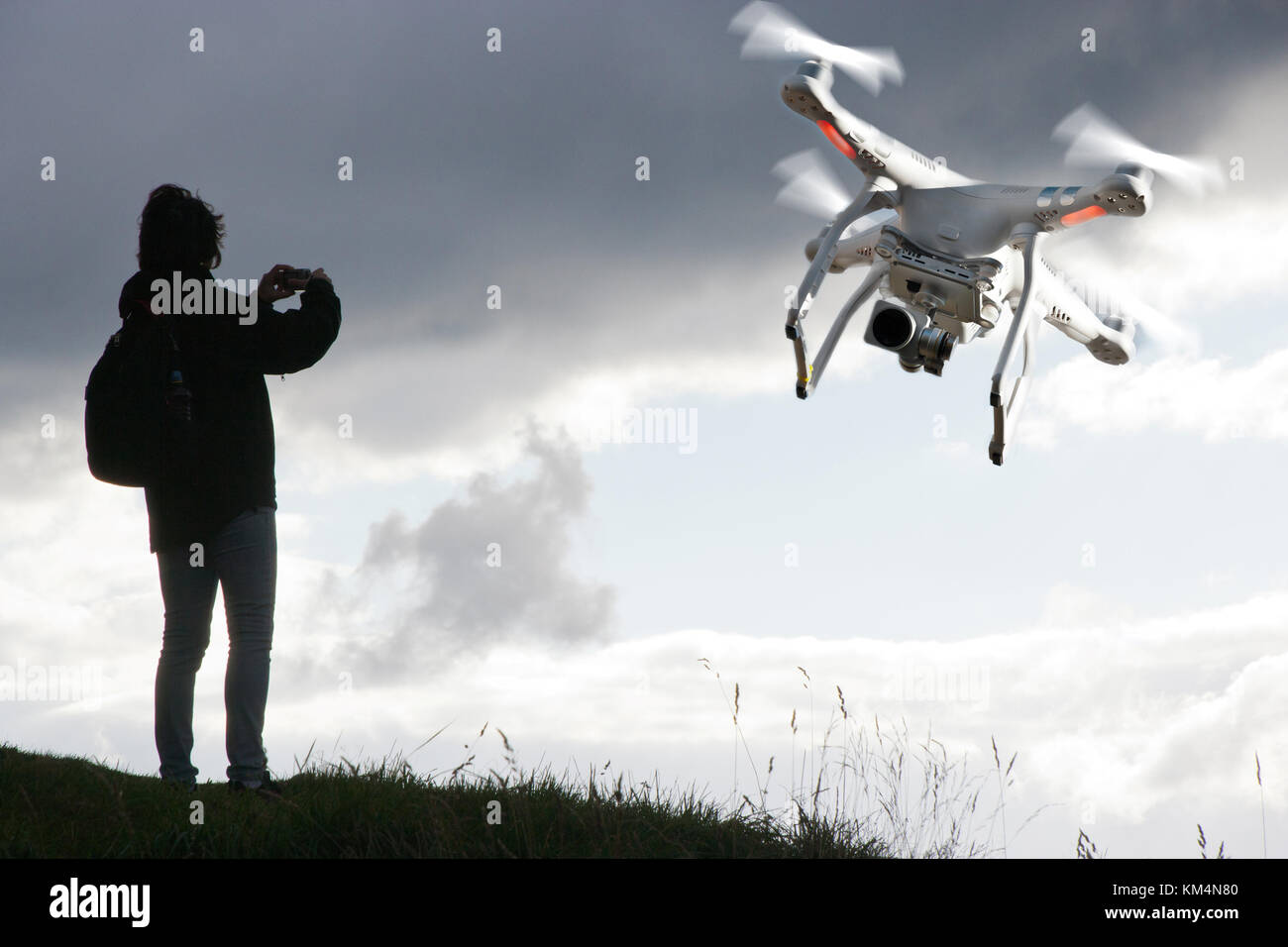 Flying drone with camera - Stock Image