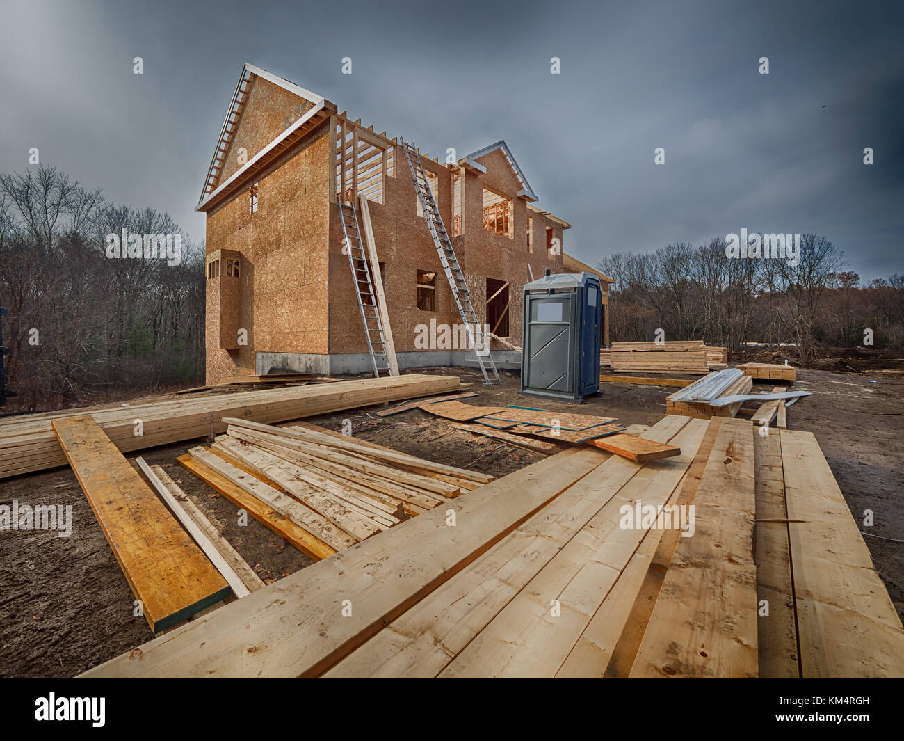 New house construction framing in the city suburbs Stock Photo