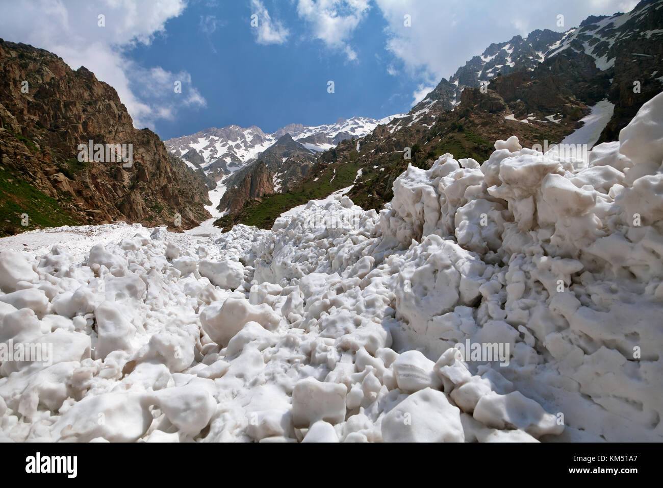 Snow after an avalanche in Chimgan mountains, Uzbekustan Stock Photo