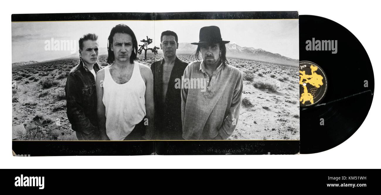 U2 Joshua Tree album, showing the opened gatefold sleeve with photos of the band - Stock Image