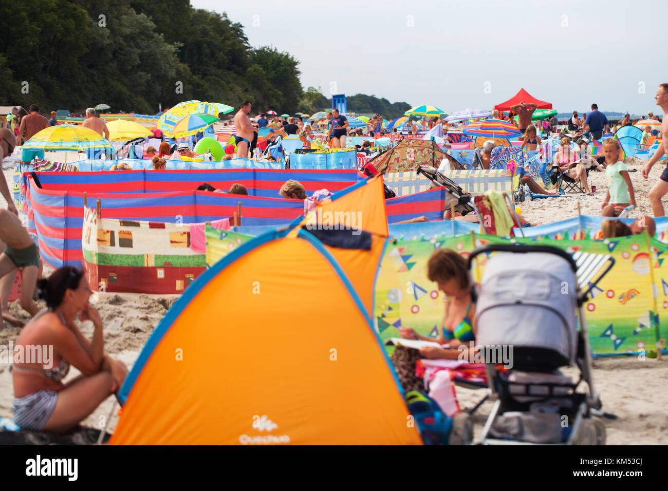 Polish sea, beach - crowds on the beach. chaos, color, screens - Stock Image