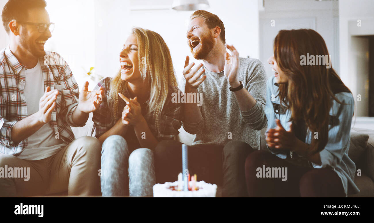 Young group of happy friends celebrating birthday - Stock Image
