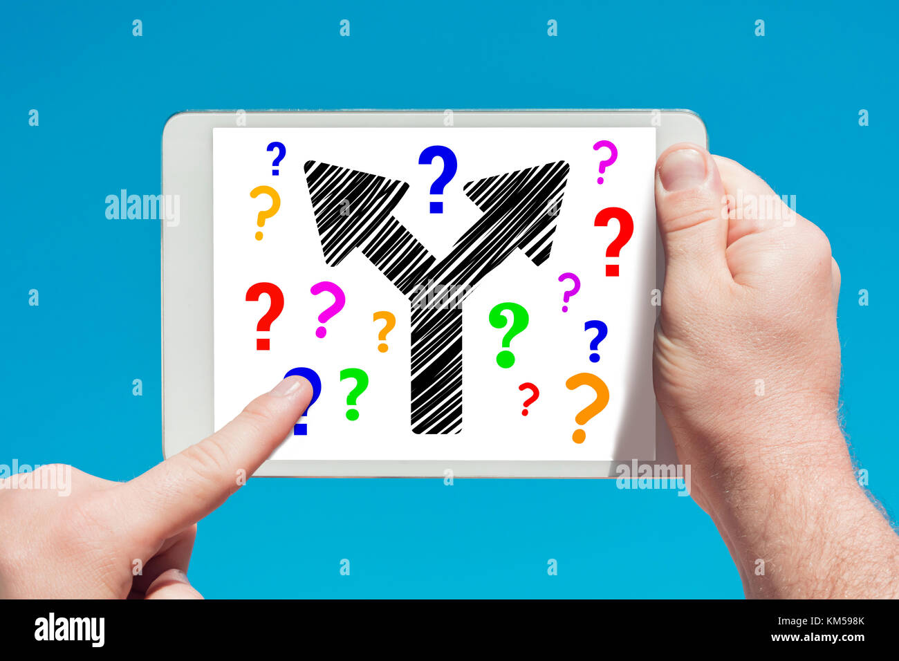 Man Holding A Tablet Device Showing Two Way Arrow Symbol Concept And