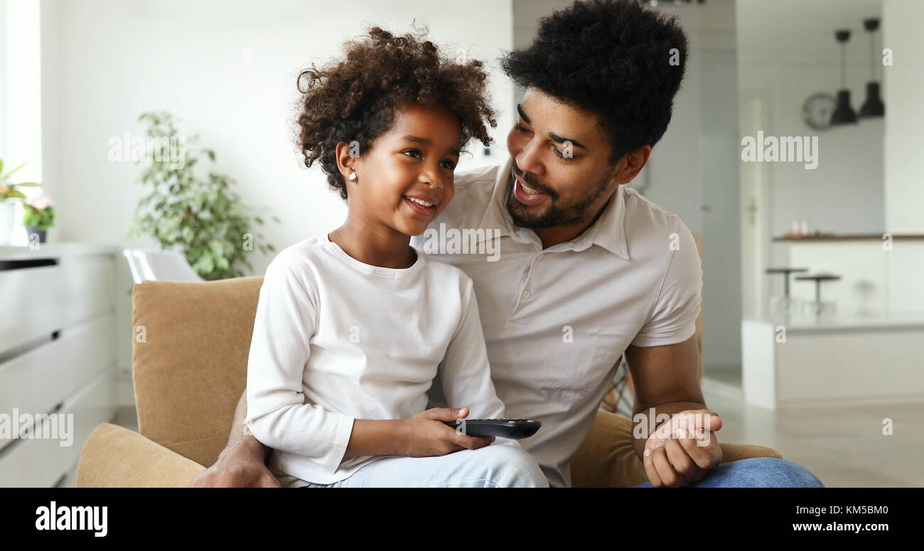 happy father and daughter and watching tv at home Stock Photo
