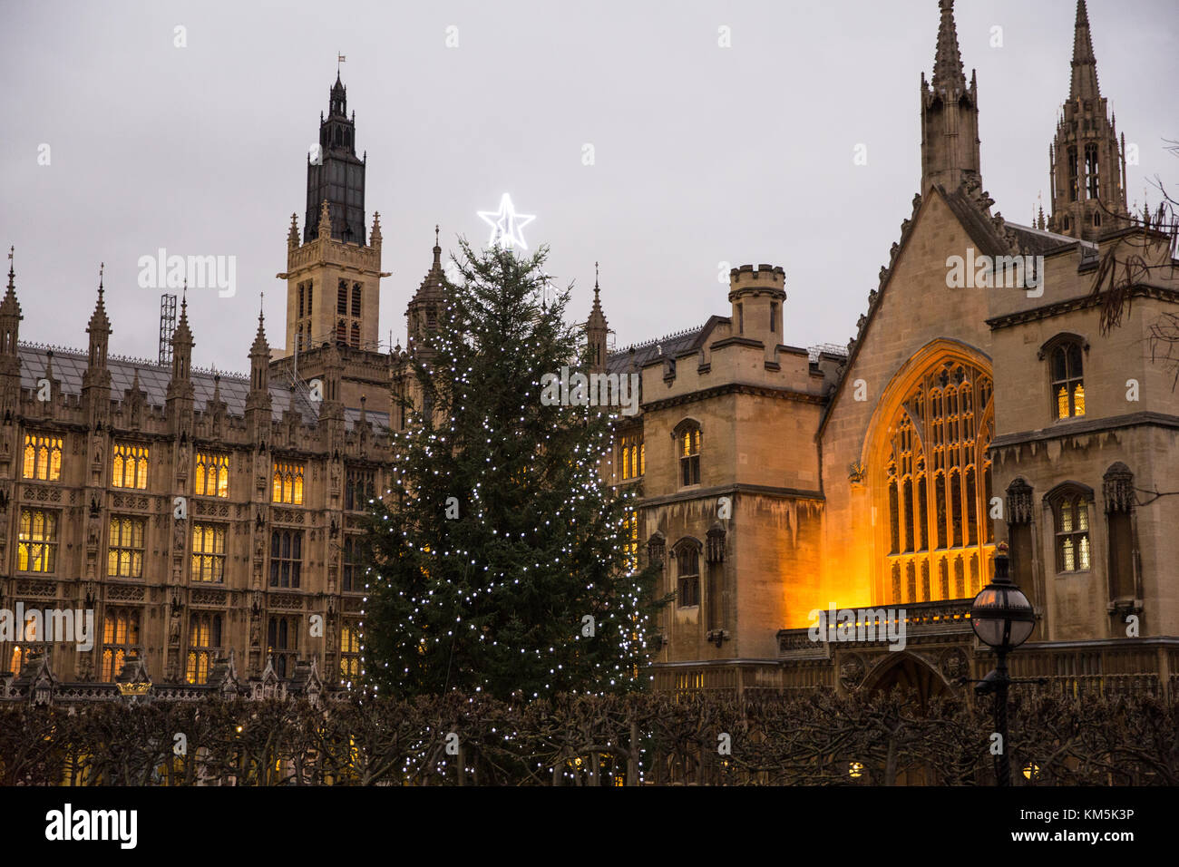a traditional decorated christmas tree stands in new palace yard in the palace of westminster credit mark kerrisonalamy live news