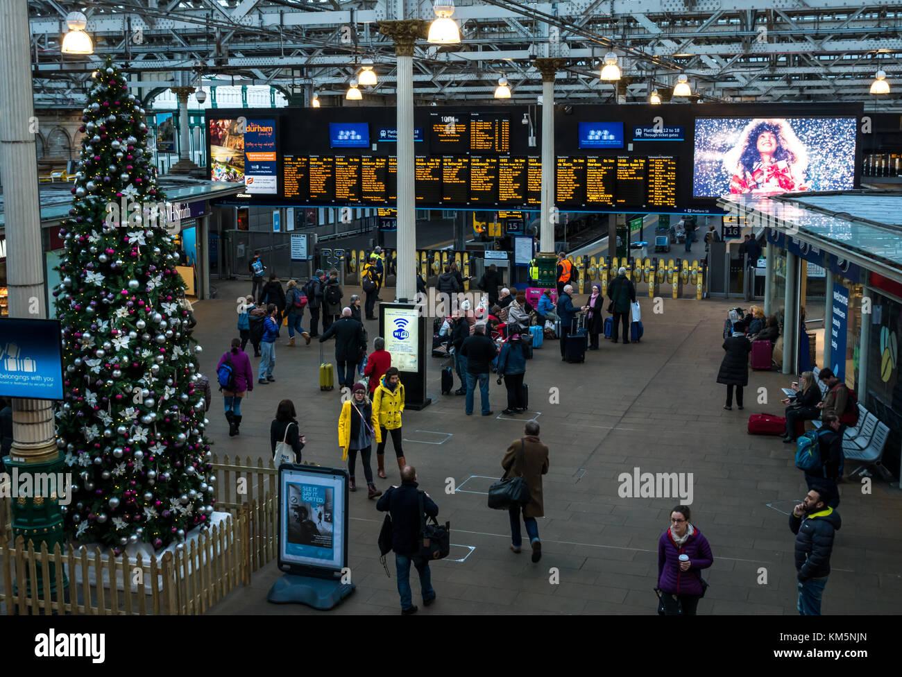 Edinburgh, Scotland, United Kingdom, 4th December 2017. Decorated Christmas tree at Waverley Station, with electronic Stock Photo