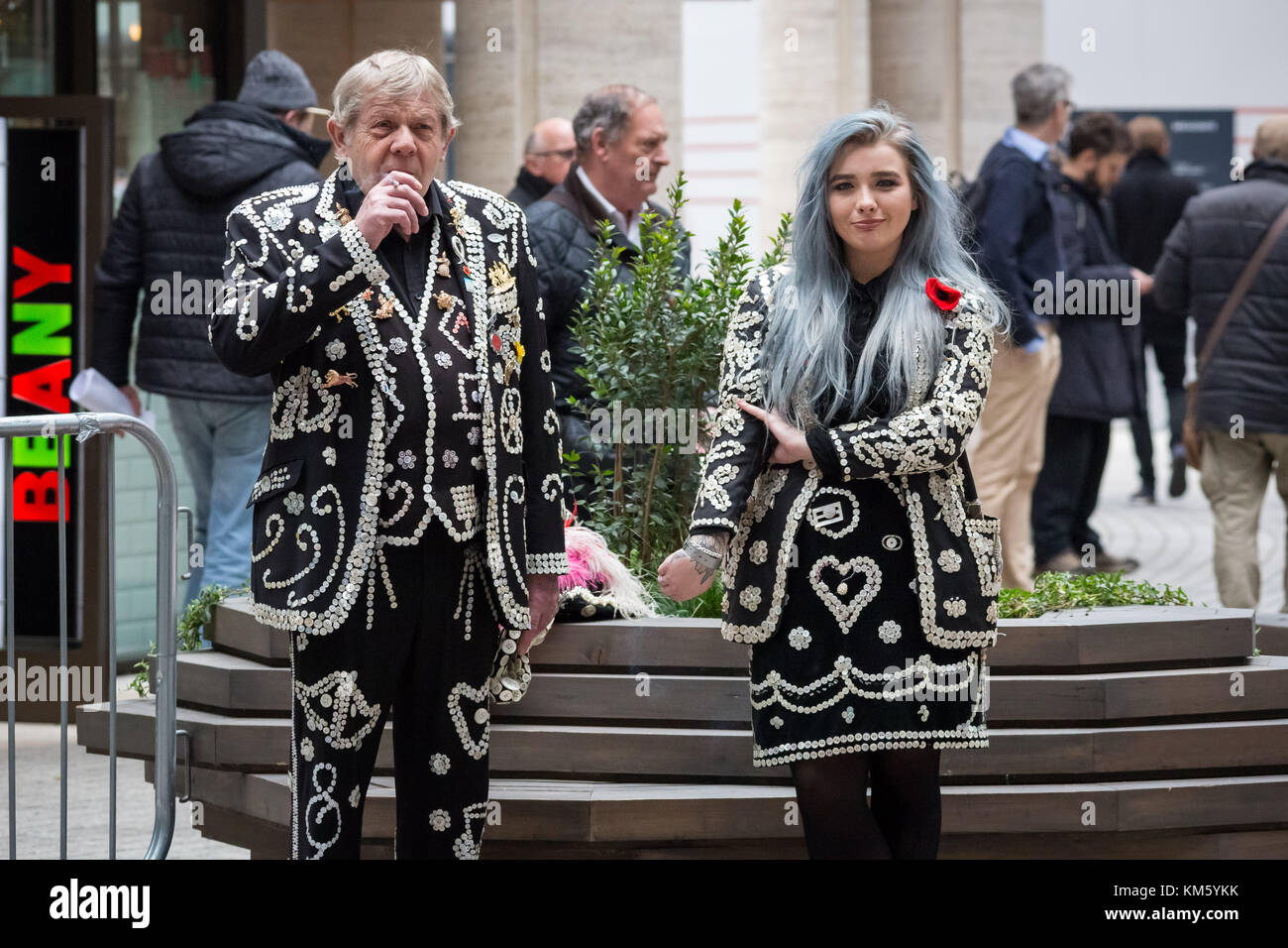 London, UK. 5th Dec, 2017. Pearly Kings and Queens, also known as Pearlies, take a break whilst attending the annual - Stock Image
