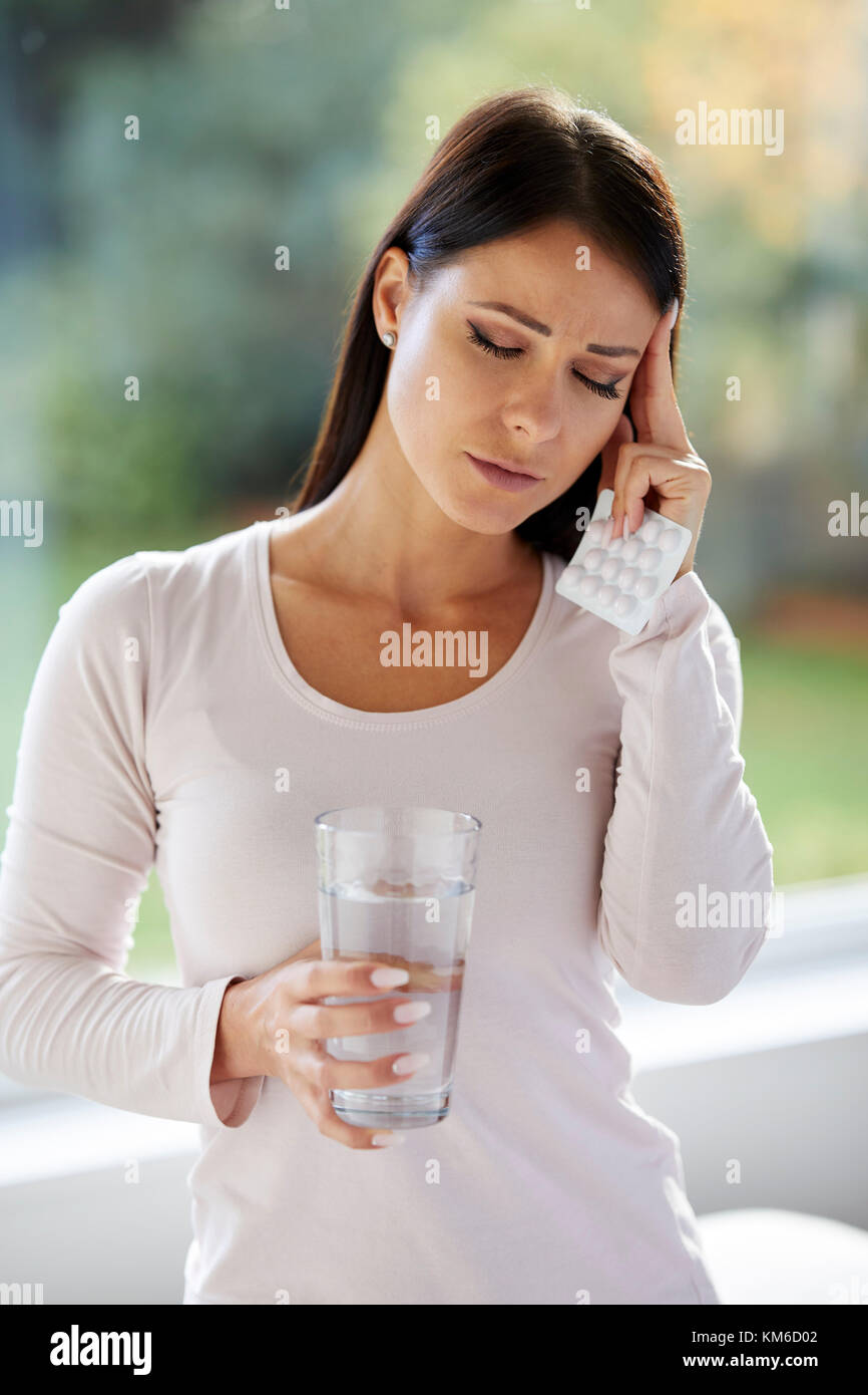 Woman holding packet of tablets - Stock Image