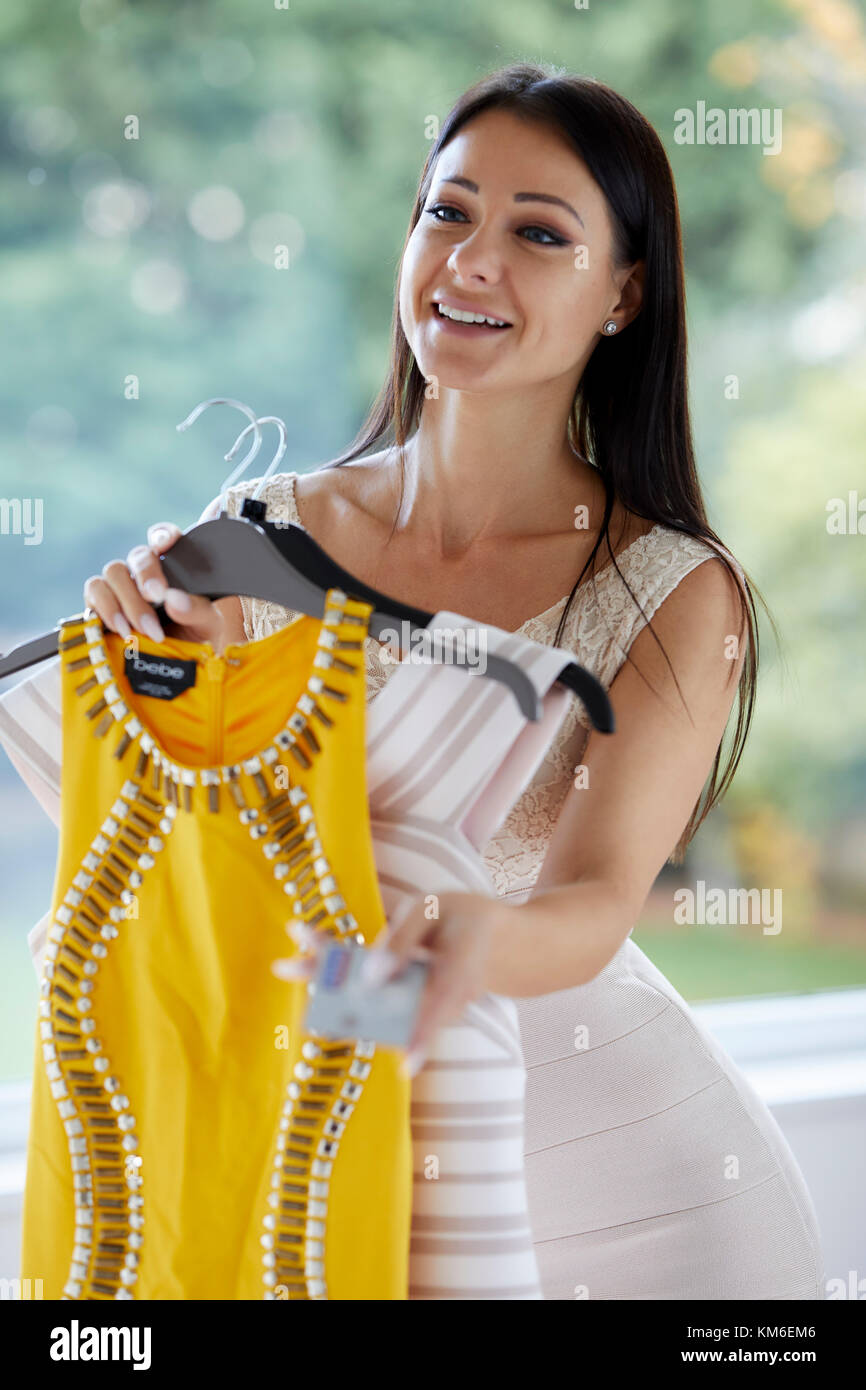 Girl paying for goods with credit card - Stock Image
