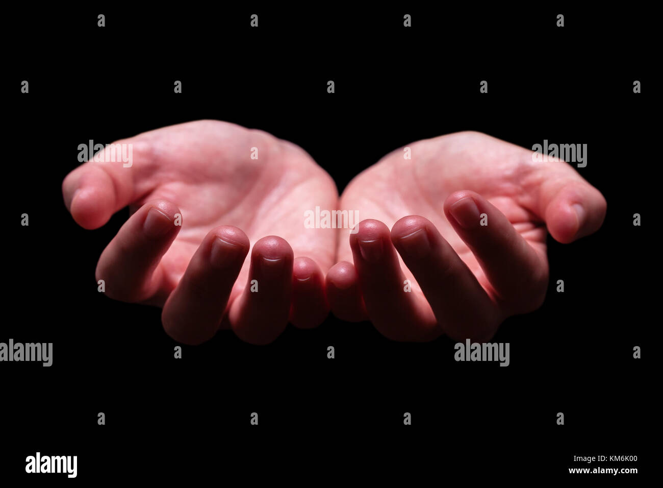 Woman hands cupped in a holding begging offering giving receiving protecting gesture. Also for praying prayer hold - Stock Image