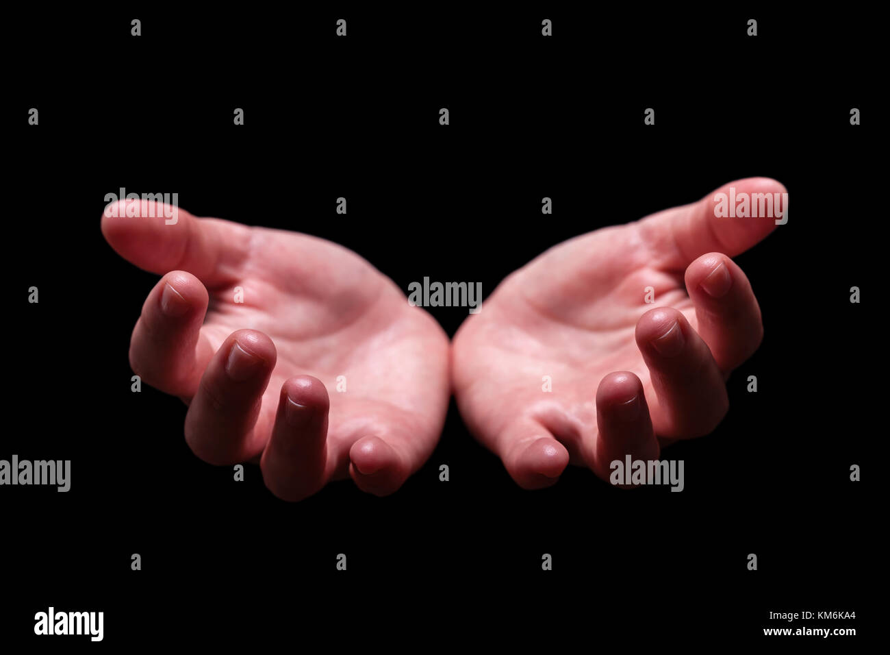 Woman hands cupped in a welcoming accepting offering giving begging receiving gesture. Also for praying prayer welcome - Stock Image