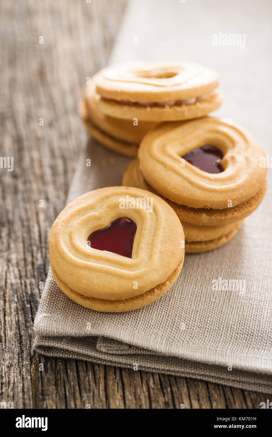 Sweet jelly cookies on old wooden table. - Stock Image