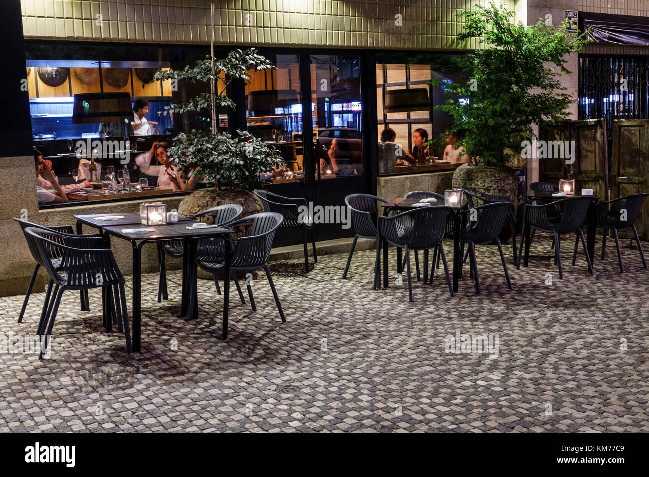 Porto portugal mercado do bom sucesso alfresco dining outdoor cafe restaurant tables exterior dusk view through window night nightlife