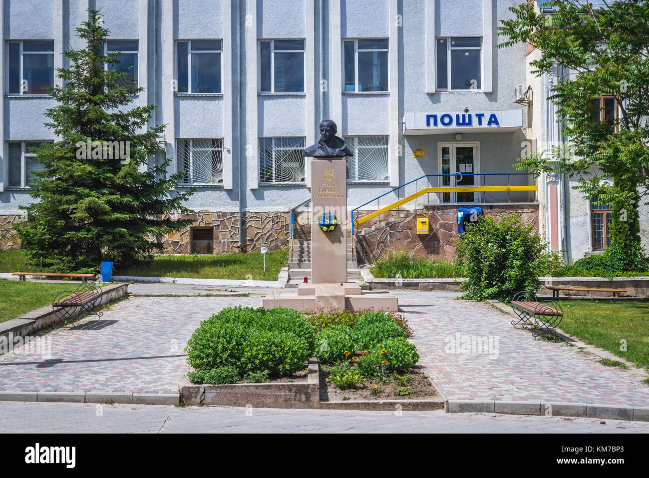Stepan Bandera monument in front of Post Office in Chortkiv city in Ternopil Oblast of western Ukraine Stock Photo