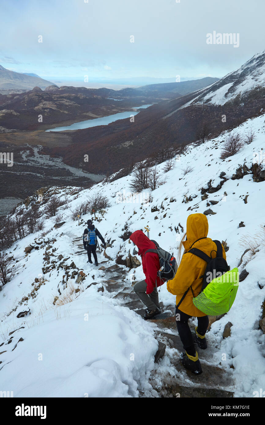 Hikers in snow on track to Laguna de los Tres, Parque Nacional Los Glaciares (World Heritage Area), Patagonia, Argentina, - Stock Image