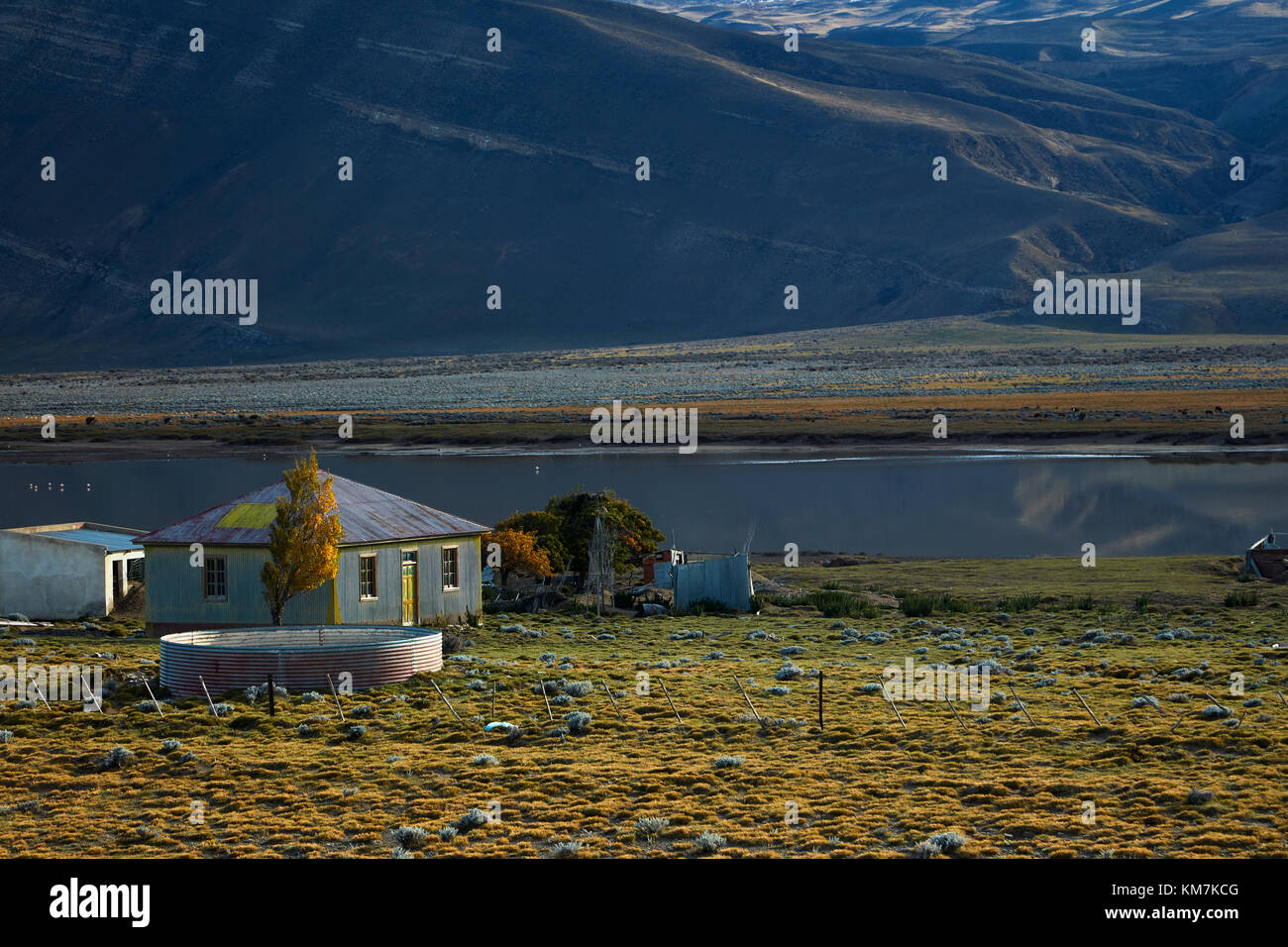 Old corrugated steel farmhouse and small lake near El Chalten, Patagonia, Argentina, South America - Stock Image