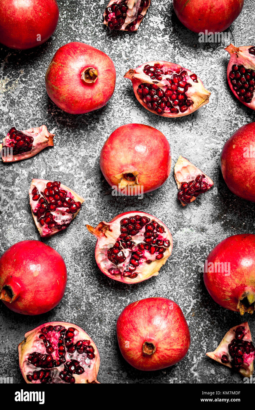 Ripe pomegranates. On rustic background. Top view - Stock Image
