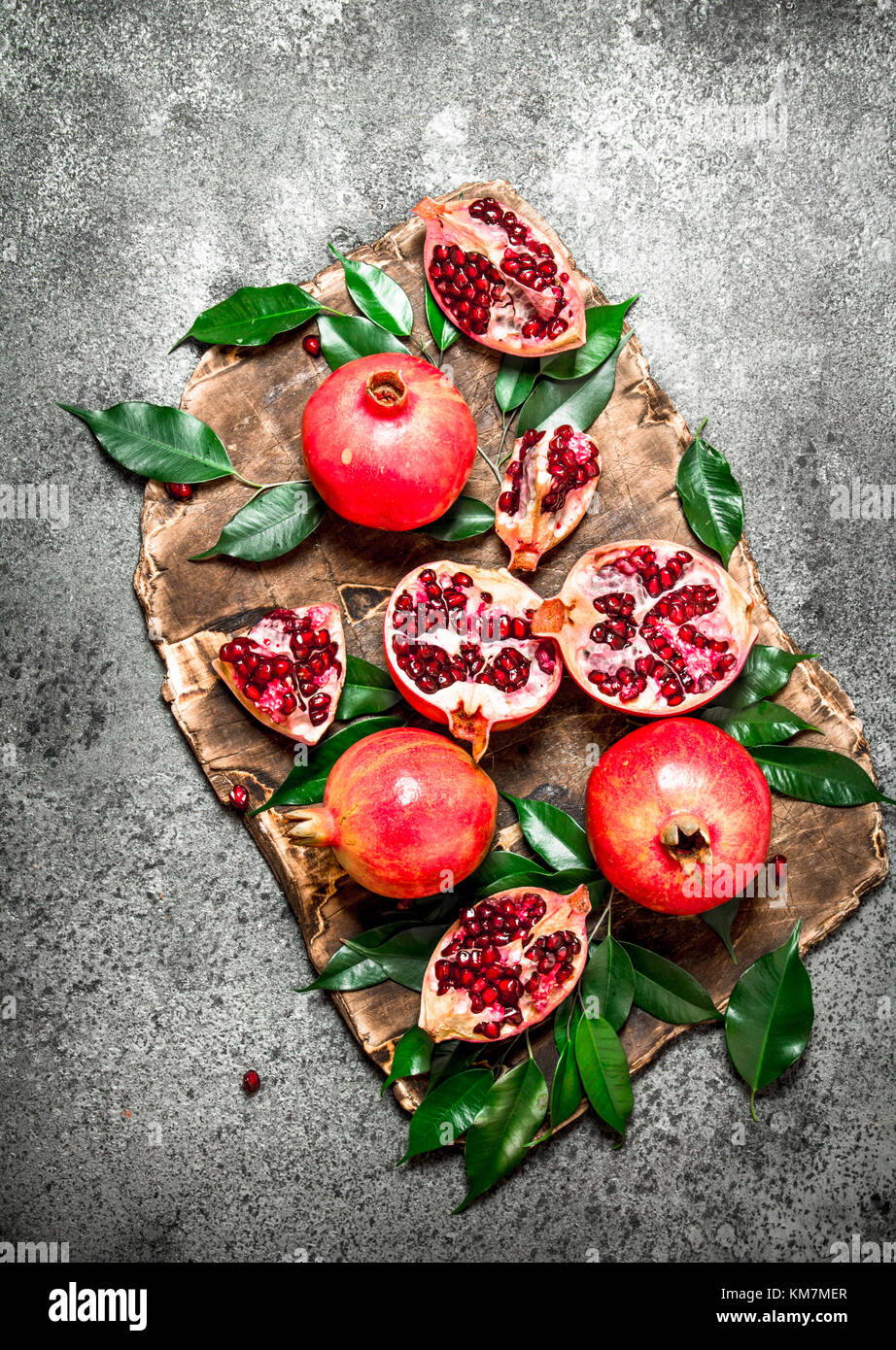 Ripe fresh pomegranates. On the rustic background. - Stock Image