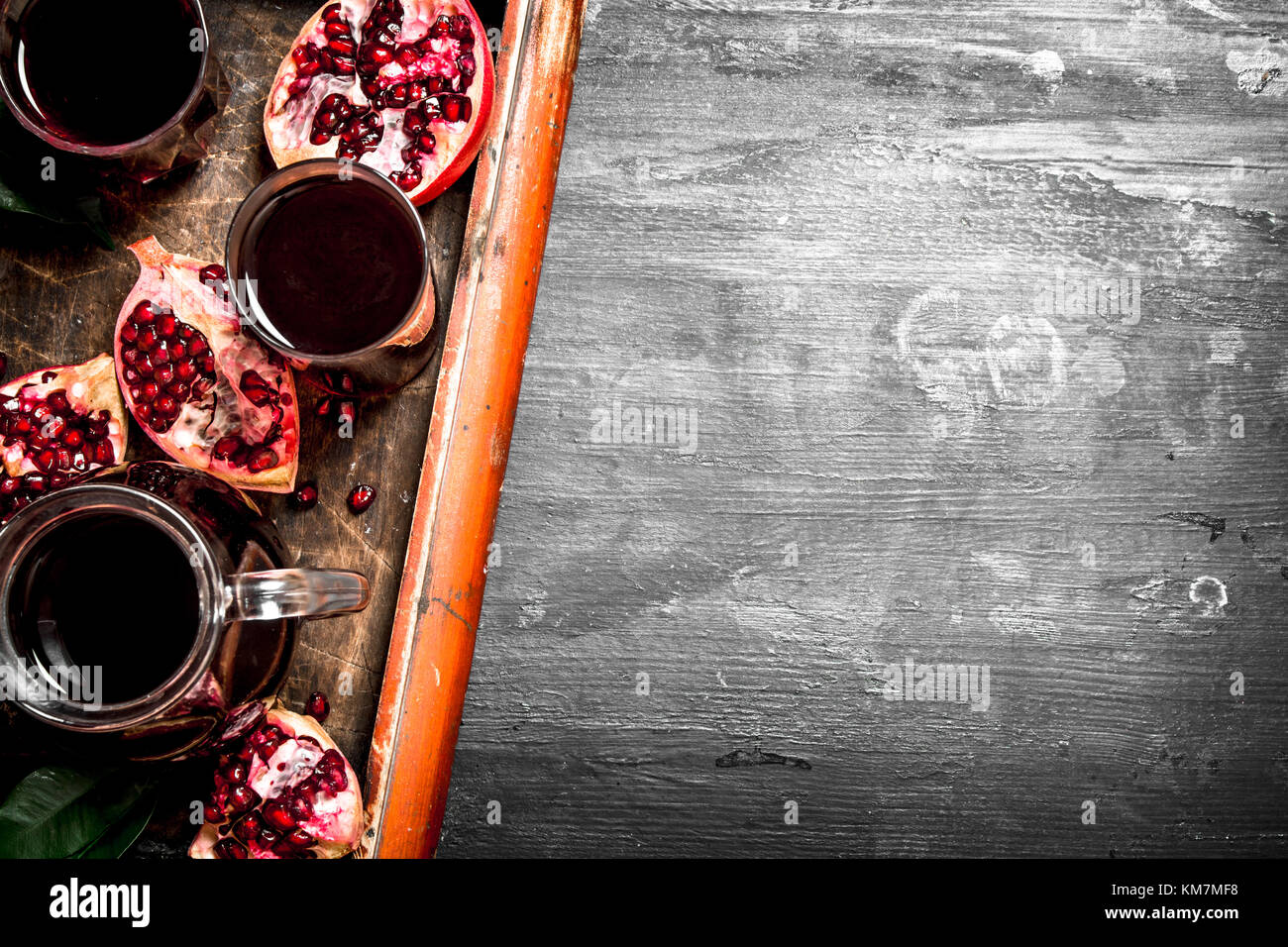 The fresh juice of ripe pomegranate. The black chalckboard. - Stock Image