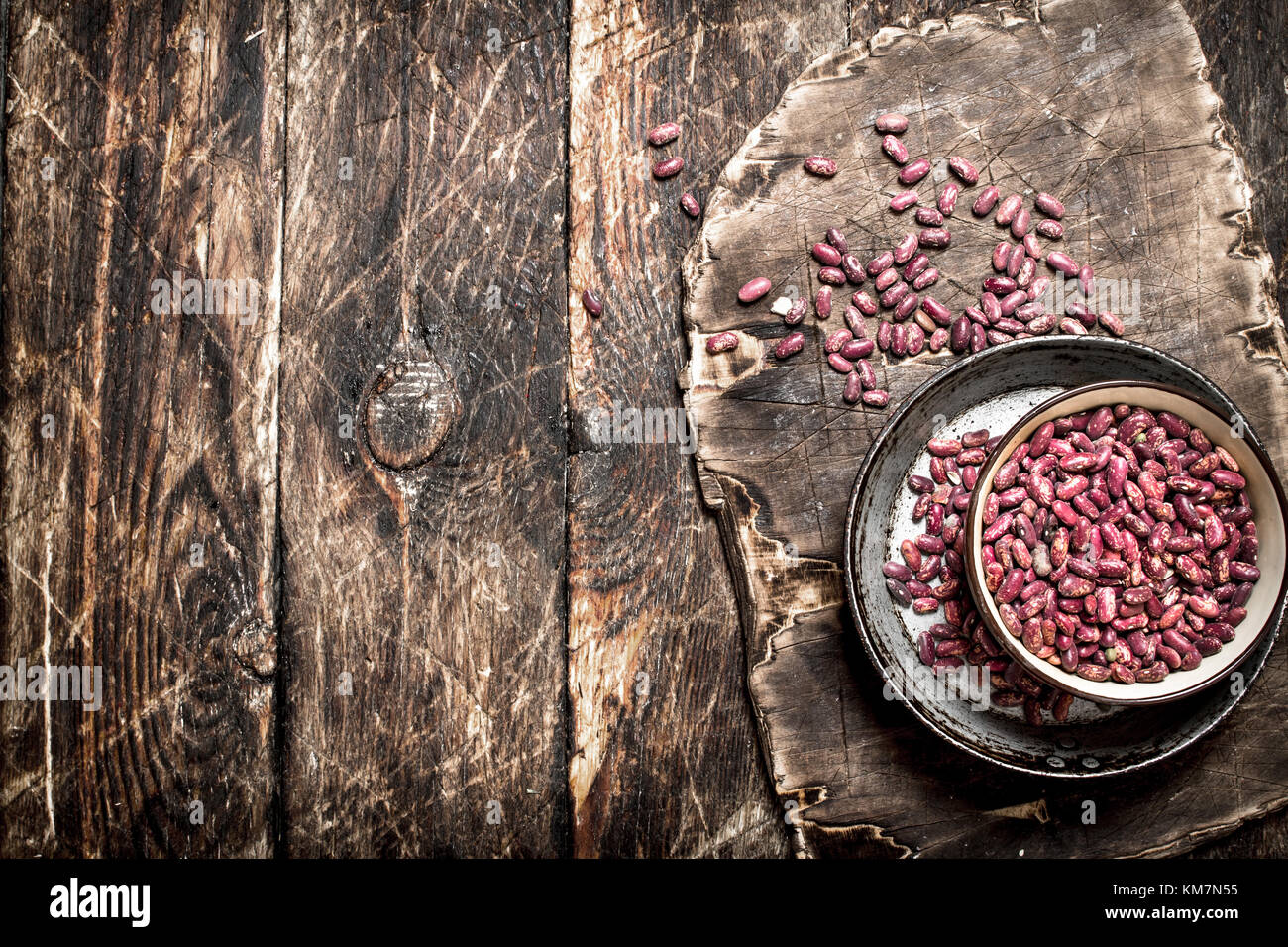 Red beans in a bowl. On a wooden table. - Stock Image