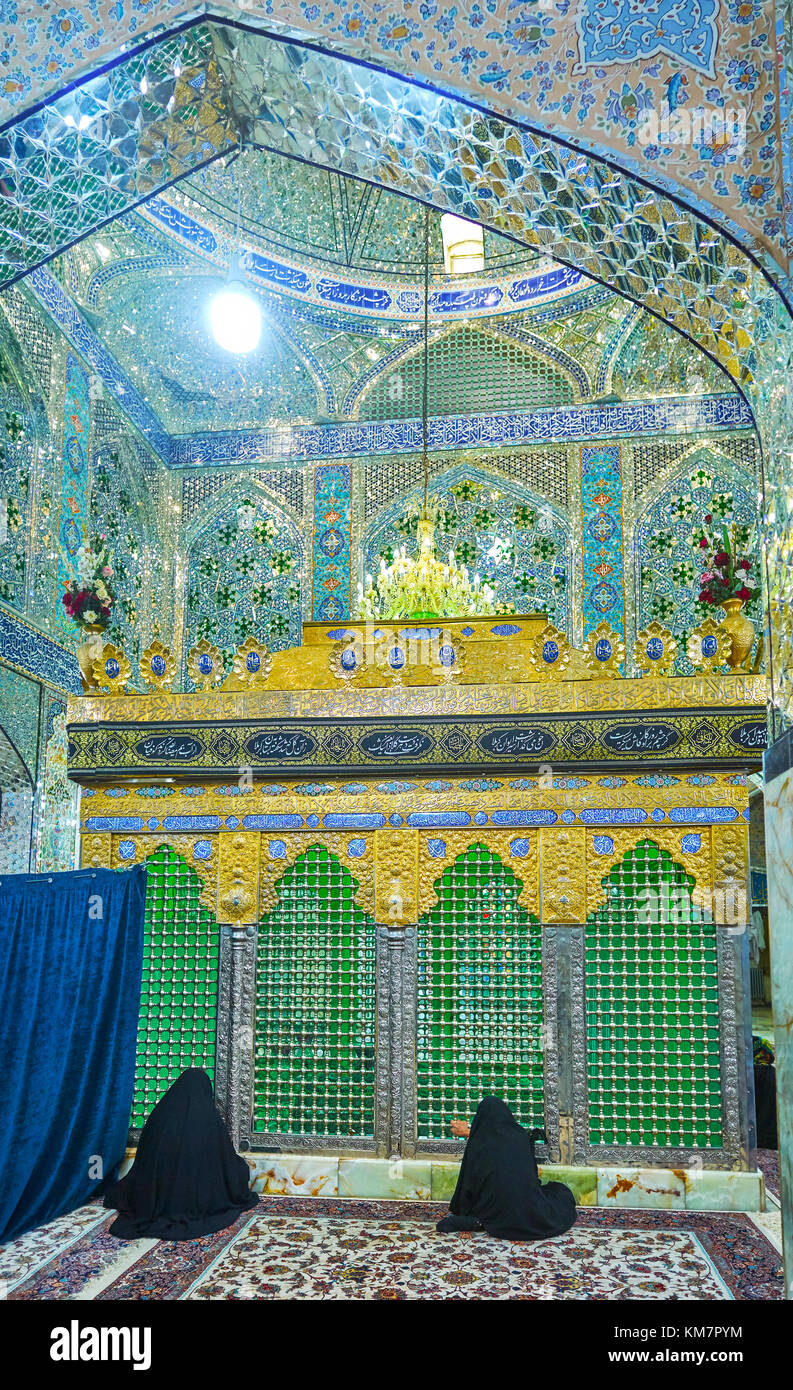 YAZD, IRAN - OCTOBER 17, 2017: Beautiful interior of Shahzade Fazel Holy Shrine with women praying in front of the Stock Photo