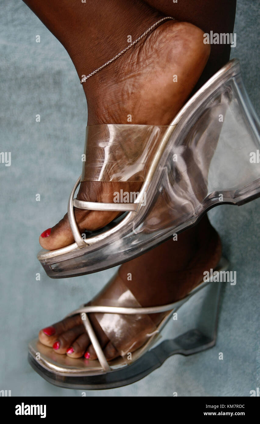 Close up of African woman's feet with shoes on - Stock Image