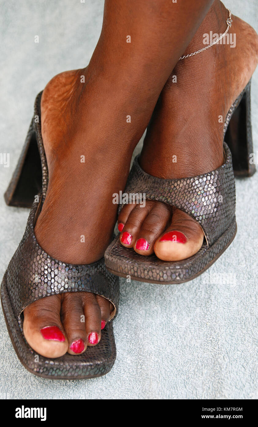 African woman wearing smart shoes - Stock Image