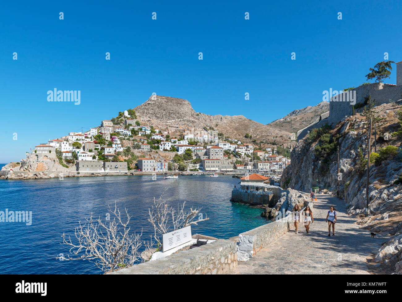 Path along the north coast looking towards Hydra Town, Hydra, Saronic Islands, Greece - Stock Image
