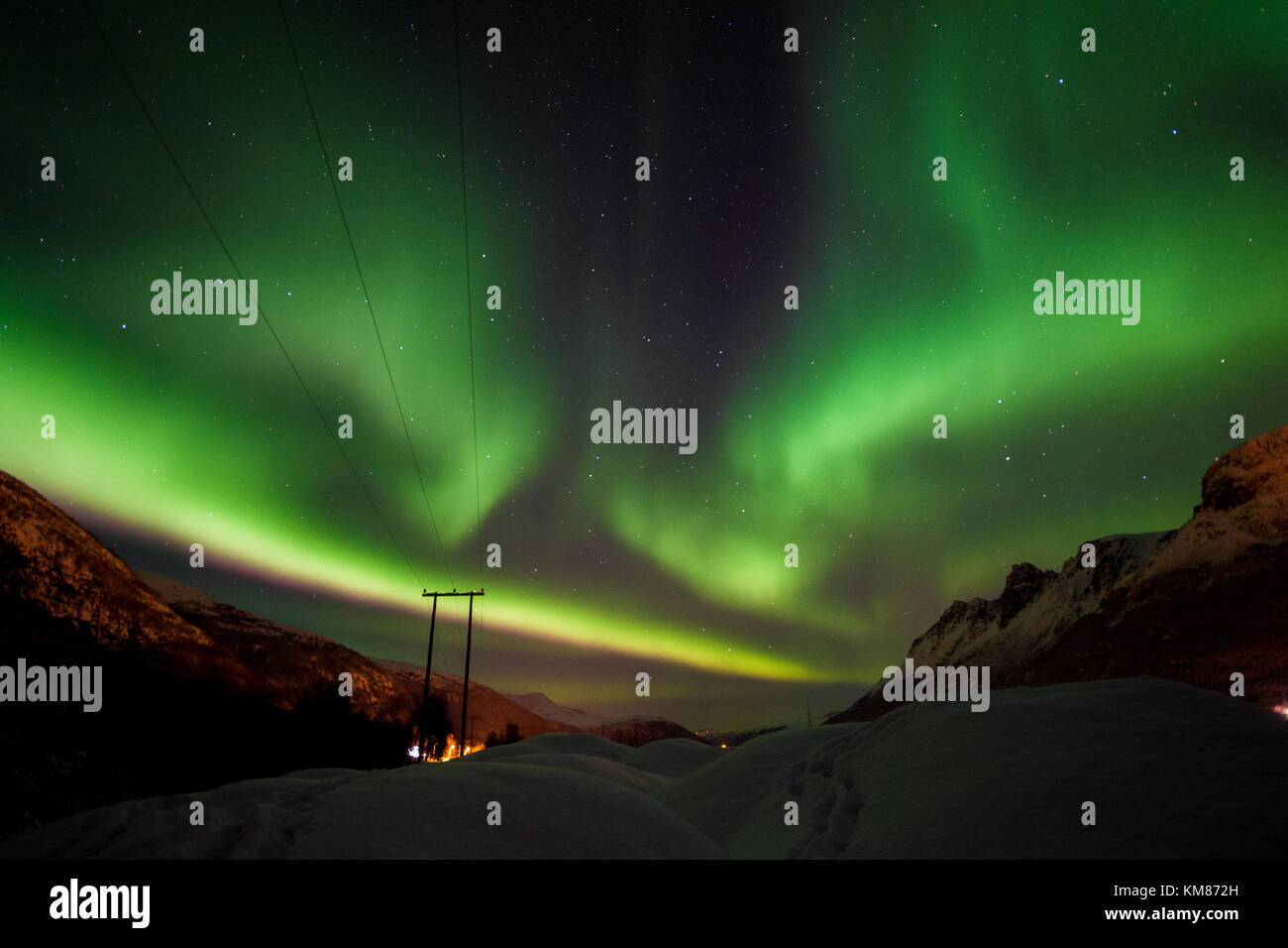 Aroura borealis over the Lyngen Alps, tromso, norway - Stock Image