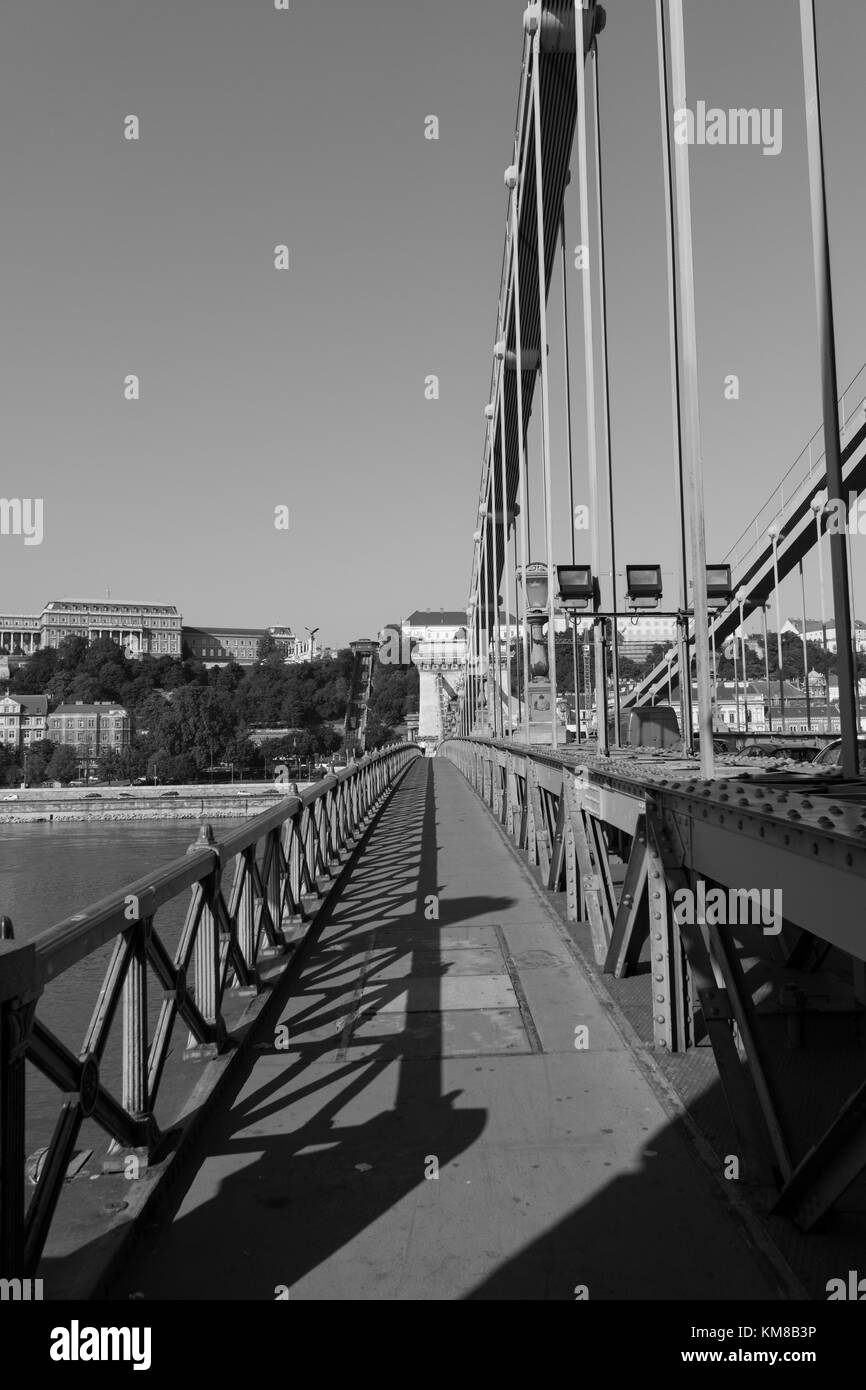 Black and white photo of Chain bridge in Budapest, Hungary during day with shadows. - Stock Image