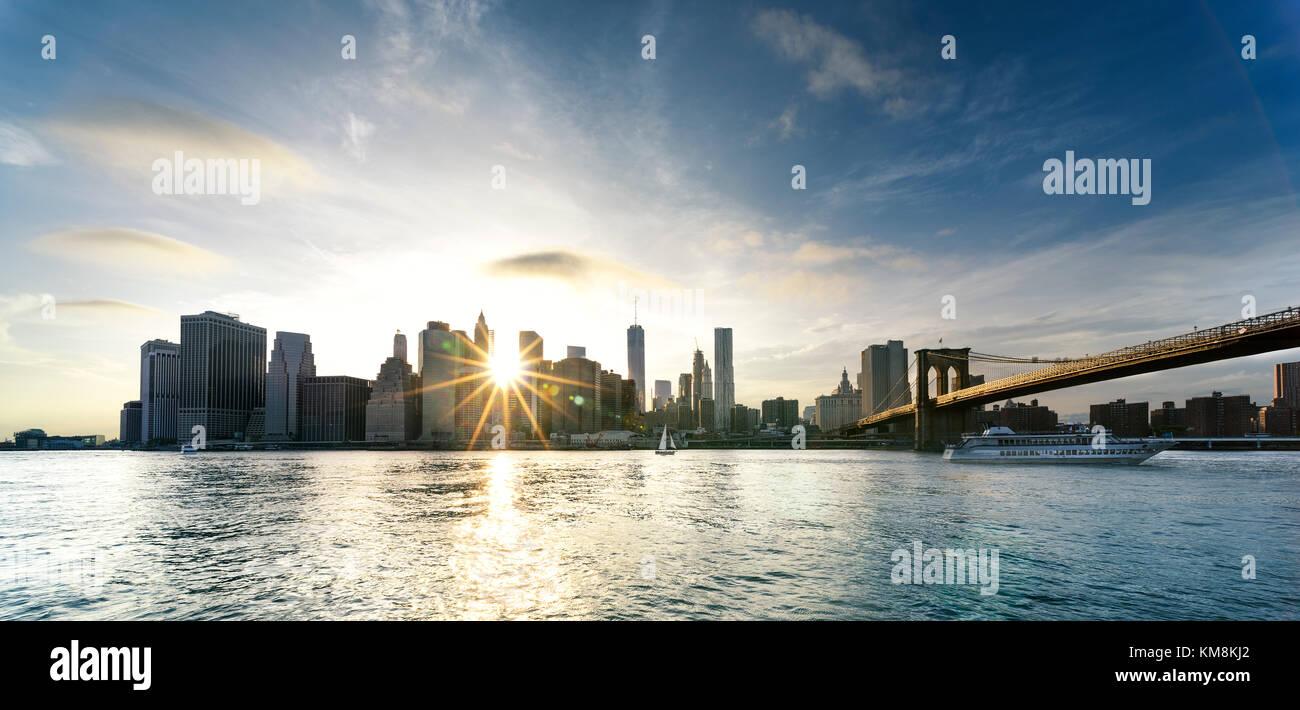 New York City - beautiful sunset over manhattan with manhattan and brooklyn bridge USA Stock Photo