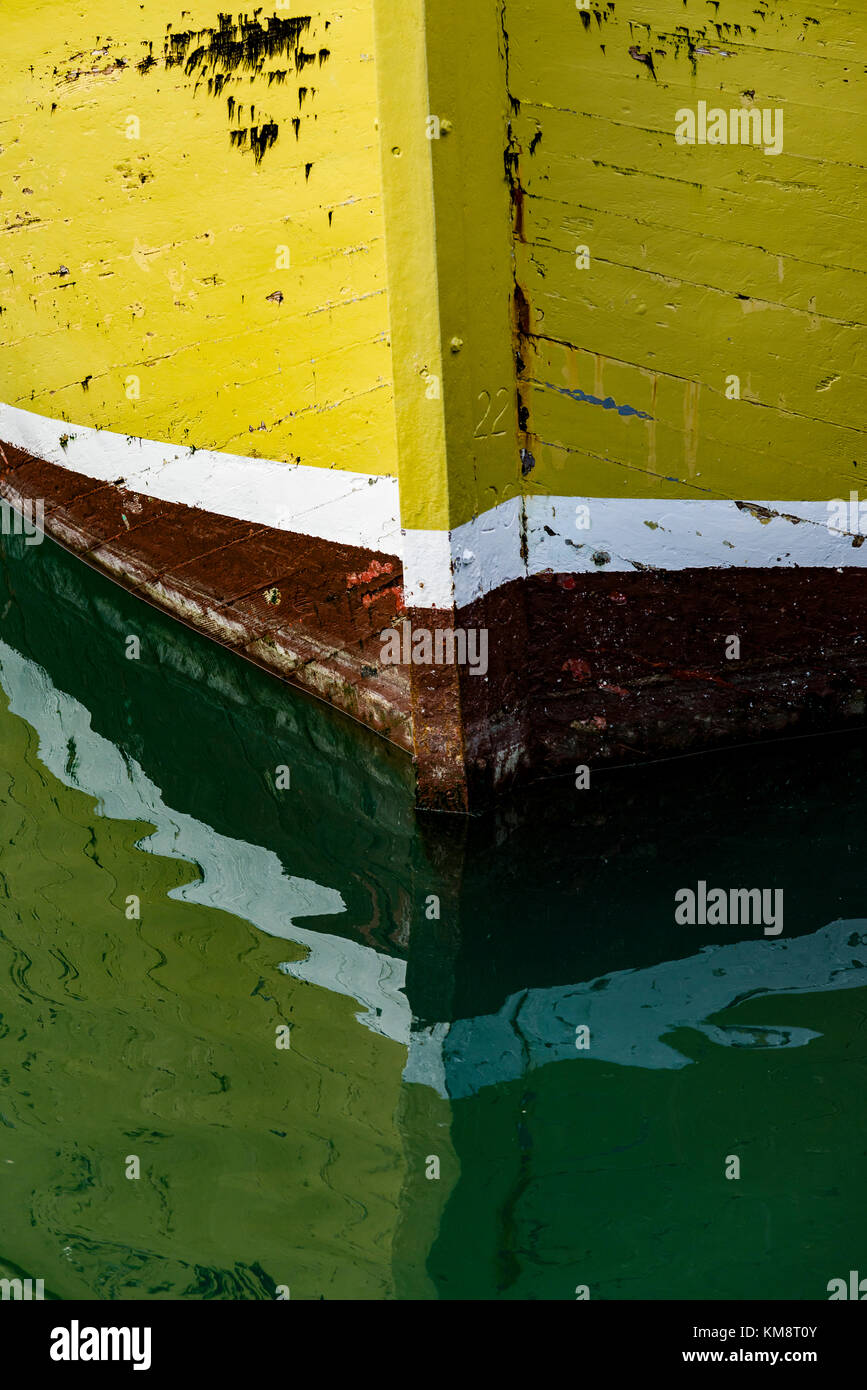 Padstow, Cornwall, South West England, UK 03/12/2017. The Weather Beaten Bow of a Fishing Boat Reflects on the Calm - Stock Image