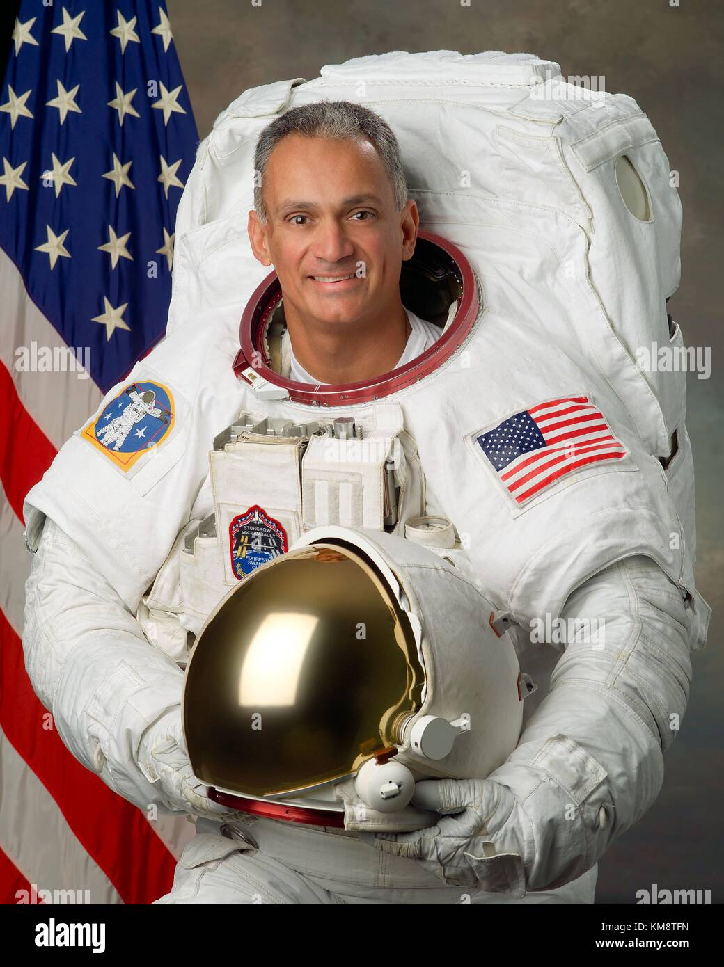Official portrait of NASA STS-117 and STS-128 mission astronaut John ÒDannyÓ Olivas in a spacesuit at - Stock Image