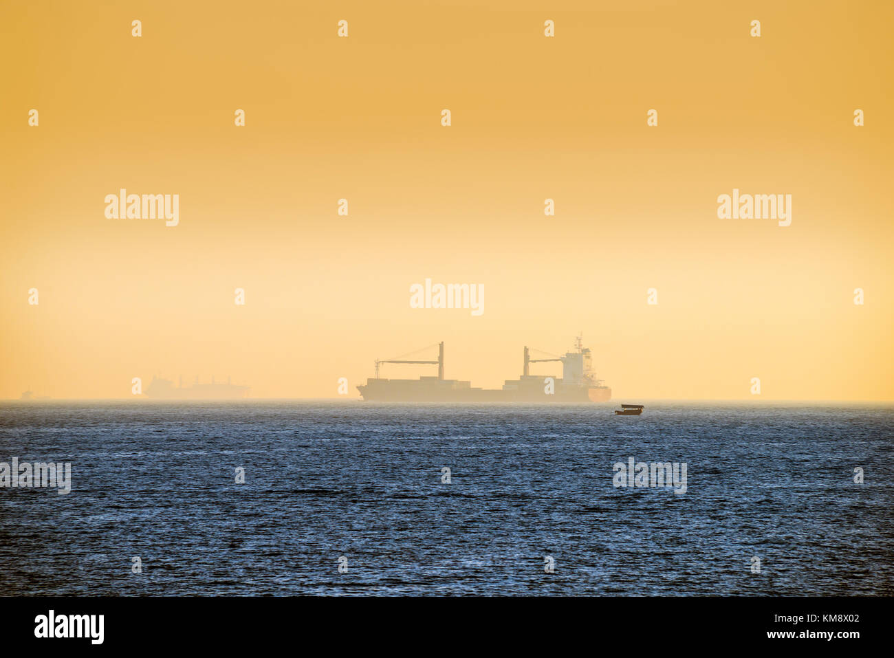 Shipping and Local Craft, South China Sea, Hong Kong, Sunset Stock Photo