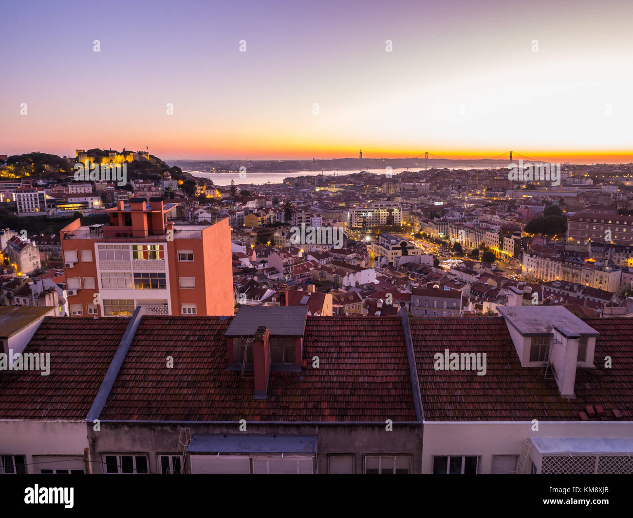 LISBON, PORTUGAL - NOVEMBER 19, 2017: The cityscape of Lisbon, Portugal, by night, shortly after sunset on a November - Stock Image