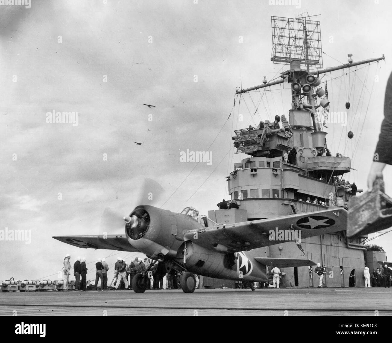 A Grumman F4F-4 Wildcat fighter taking off from USS Ranger (CV-4) to attack targets ashore during the invasion of - Stock Image