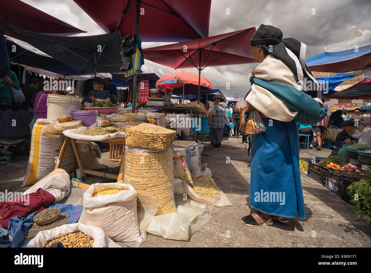 Otavalo, Ecuador - December 2, 2017: closeup of an indigenous woman wearing traditional dress standing in the Saturday - Stock Image