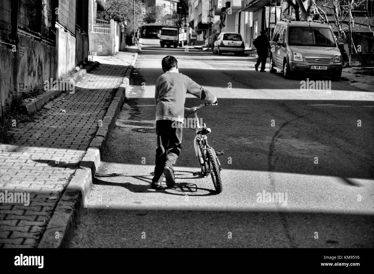 child, street, bike, hope, justice - Stock Image