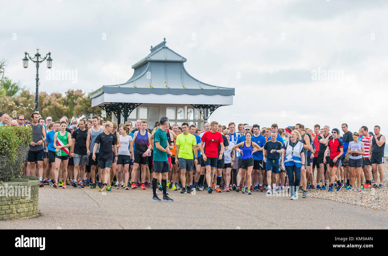 Large group of runners waiting to start the race at a Vitality Parkrun event in Worthing, West Sussex, England, - Stock Image