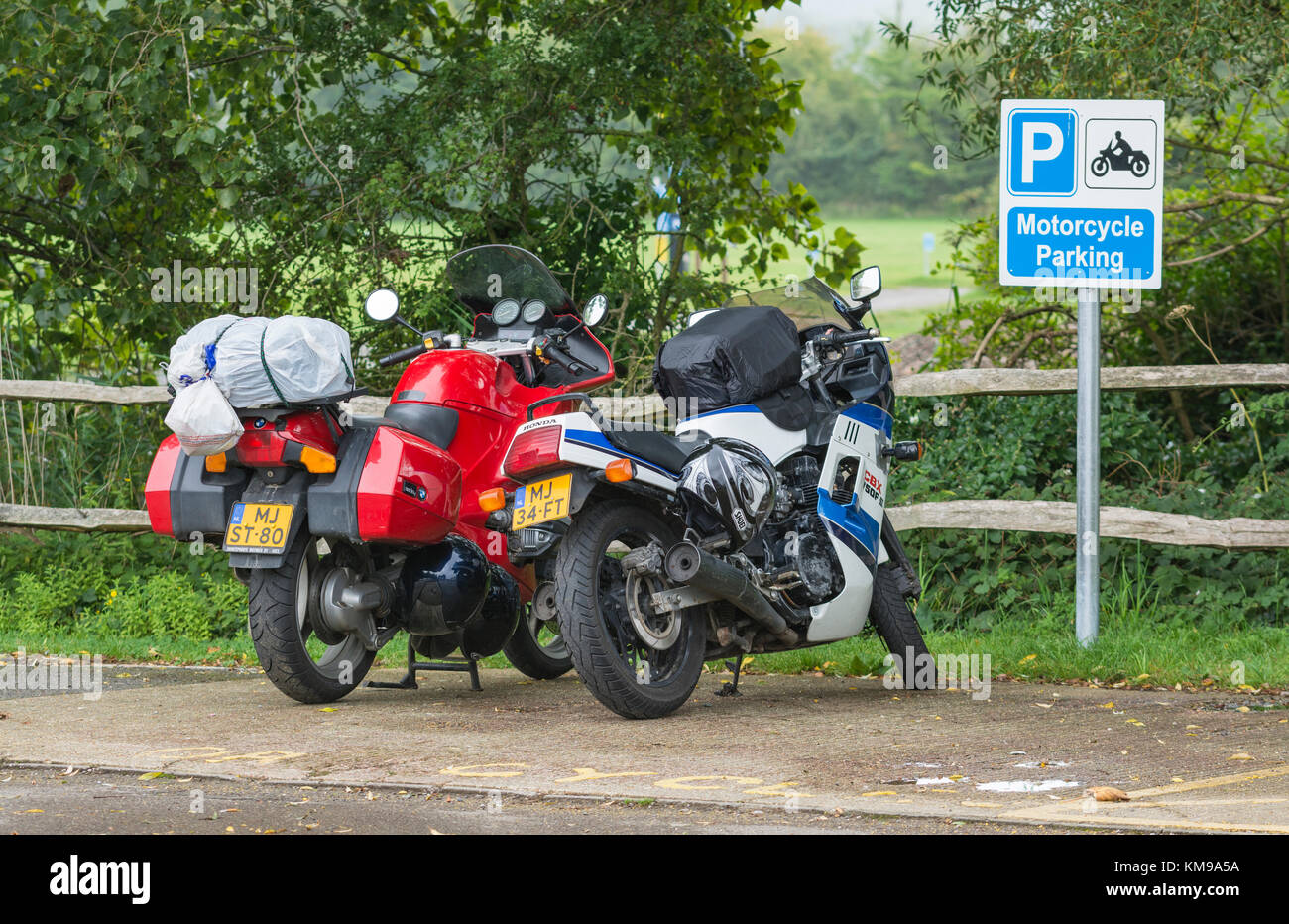 Motorcycle parked in an area of a car park reserved just for motorbikes, in the UK. - Stock Image