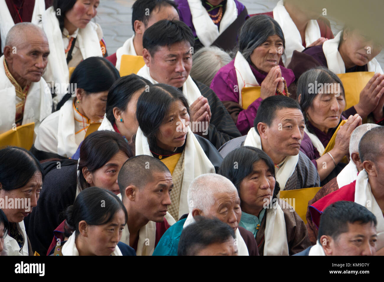 Buddhist disciples listening to His Holiness the 14th Dalai Lama at Namgyal Monastery in McLeod Ganj, India - Stock Image