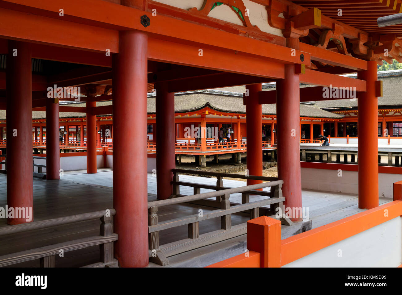 Miyajima - Japan, May 26, 2017: Long corridors and pillars at the famous the Itsukushima Shrine on Miyajima - Stock Image