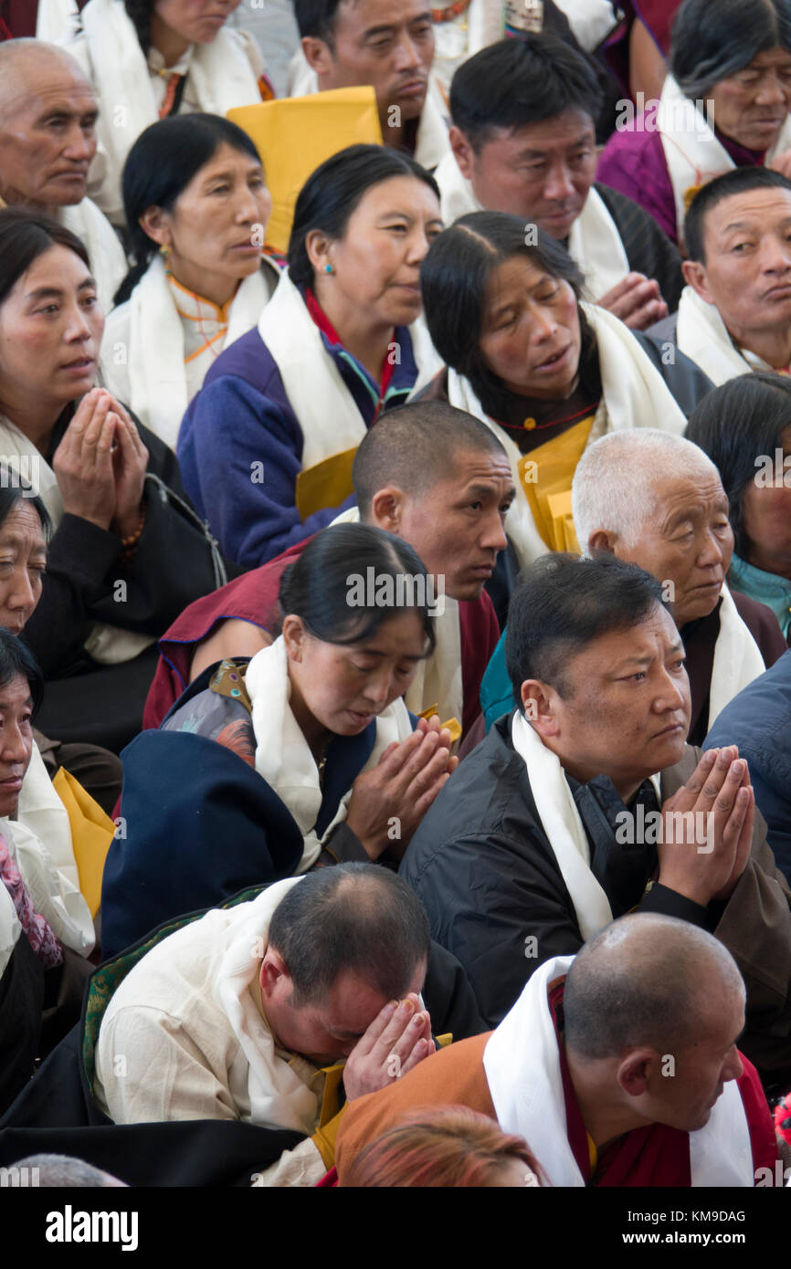 Buddhist disciples listening to His Holiness the 14th Dalai Lama at Namgyal Monastery in McLeod Ganj, India Stock Photo