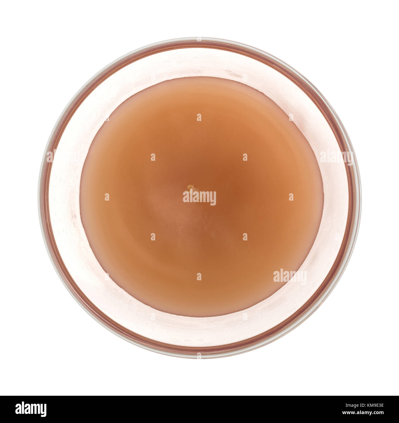Top view of an unlit scented candle in a boutique glass isolated on a white background. - Stock Image