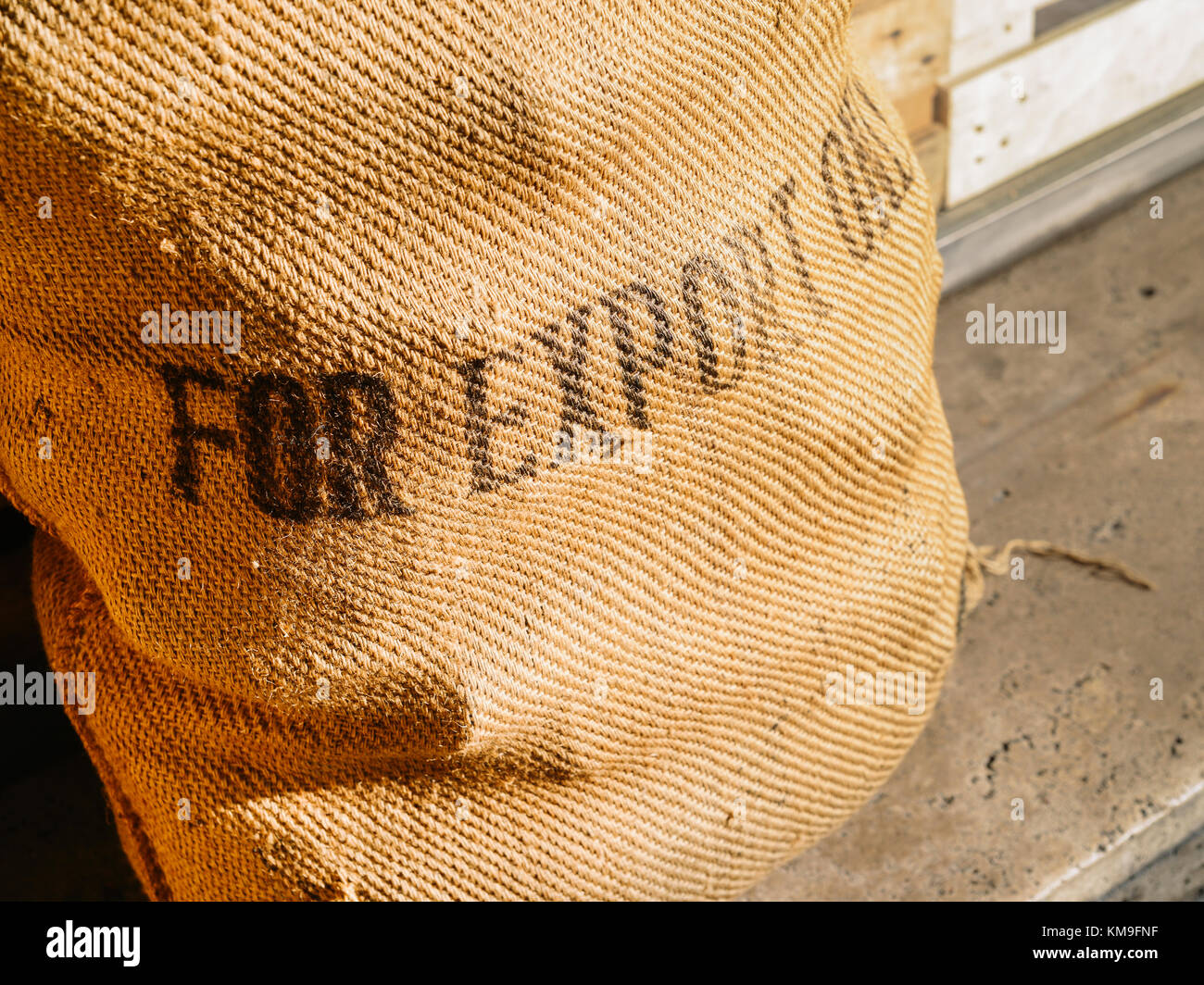 Rustic coffee bean bag with 'For Export Only' written on front - logistics import/export concept - Stock Image