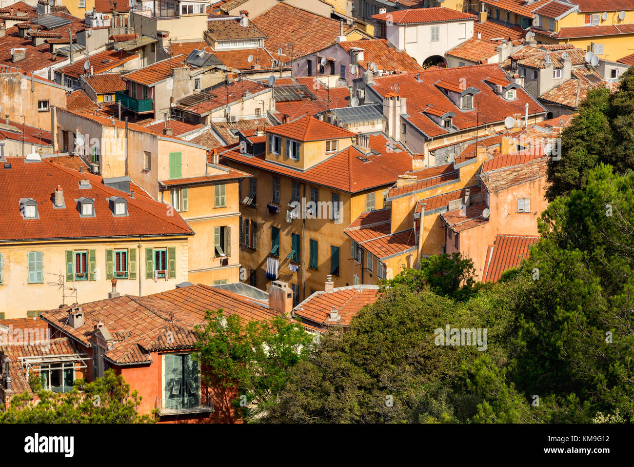 Roofs of Nice in summer with their distinctive terracotta tiles and louvered shutters. French Riviera, Alpes Maritimes, - Stock Image