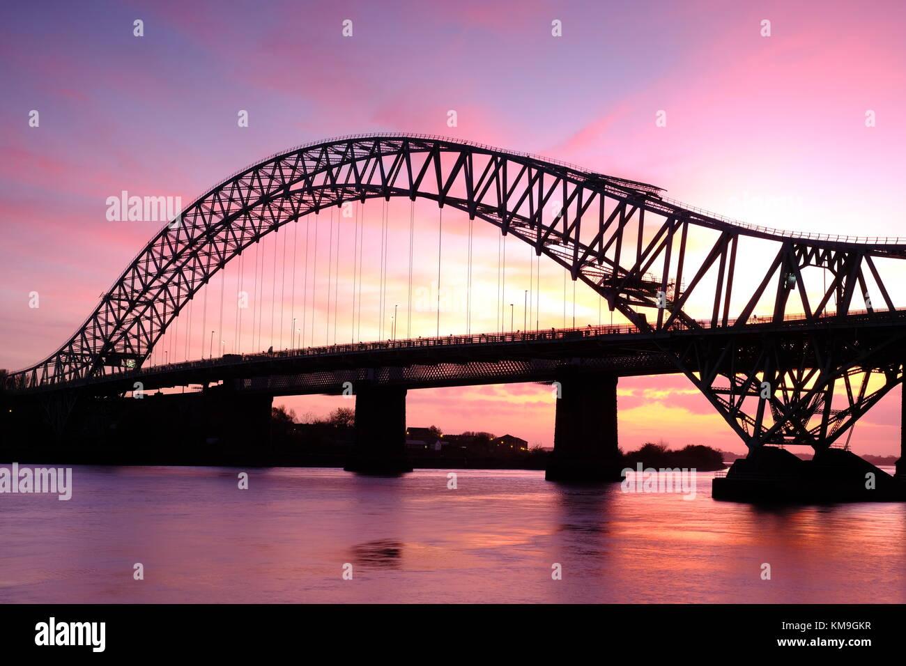 Runcorn Bridge, also known as Runcorn-Widnes Bridge or Silver Jubilee Bridge, over the River Mersey, UK - Stock Image