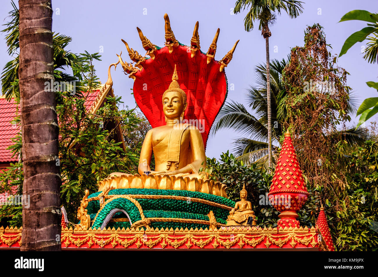 Vientiane, Laos - March 16, 2013: Golden Buddha statue seated on lotus flower at Buddhist temple Wat That Luang - Stock Image